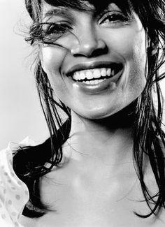 Smiling Rosario Dawson