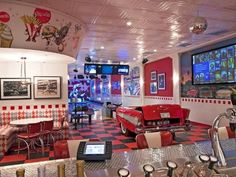 by Bronson Harrington  This awesome 1950's diner inspired modern home theater has an old world feel but features all the modern tech required - this even has a bowling alley in the back! Image via hgtvremodels.com