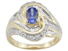 """.45ct oval tanzanite with .22ctw baguette and round diamond 10k yellow gold ring. Measures approximately 1/2""""L X 1/16""""W."""