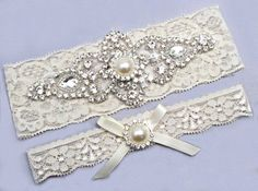 Made with ivory or white elastic stretch lace and crystal rhinestones. The keepsake garter has a large rhinestone decoration that is 2 1/2 x 6