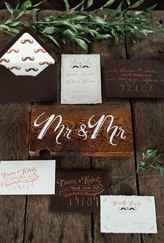 Brides.com: . Urban grooms will love the rustic elegance of minimal wooden details, rich greenery and fun mustache motifs, created by Belovely Floral and OH MAI art creations.