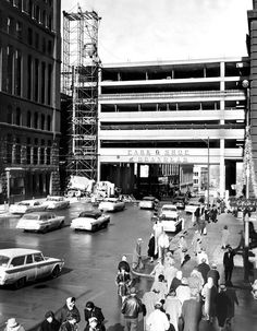 Northbound traffic on 17th Street between Farnam and Douglas Streets flowed freely under the construction of the new Brandeis parking garage on Jan. 4, 1961. THE WORLD-HERALD