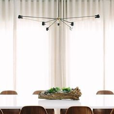 Our Long Cord Chandelier in Black and Brass via @septemberworkshop  by @marycostaphoto #yourspaceourlights #tensegrity