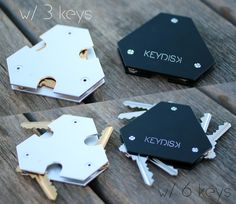 KeyDisk™- The World's Thinnest, Most Intelligent Key Holder by KeyDisk Co. — Kickstarter.  Constructed from sandblasted and anodized aluminum, weighing only 1.2 oz, finally front pocket worthy.