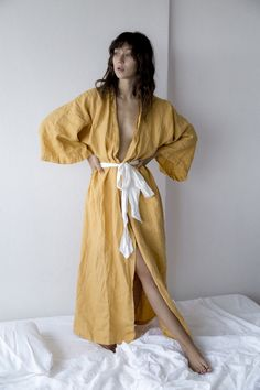 full length japanese inspired kimono robe (one size fits all)  features a contrasting white linen waist tie and extra wide sleeves  low hidden pockets on the side seams   made from 100% stone washed french linen
