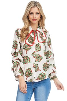30a8d156aa6a5 A stylish top with full button ups, colorful floral prints on the fabric,  and puffy ridged sleeves. Includes a bow tie on the neck.