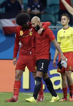 Belgium's Marouane Fellaini, left, greets United States' goalkeeper Tim Howard after the World Cup round of 16 soccer match between Belgium and the USA at the Arena Fonte Nova in Salvador, Brazil, Tuesday, July 1, 2014. Belgium won the match 2-1 after extra-time