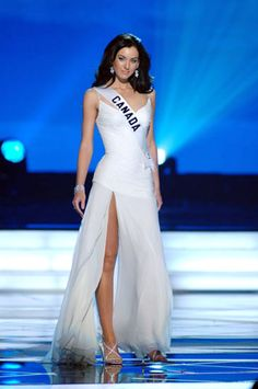 Miss Universe 2005 Natalie Glebova of Canada wearing a white evening gown designed by colombian designer Miguel de la Torre.
