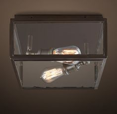 RH's Union Filament Wide Flushmount:Our clear-paned fixture holds Edison-style filament bulbs, creating a showcase for the luminescent beauty of early electrical lighting.