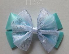 Up for your consideration is a custom made Pascal mini hair bow. The bow measures 3 inches wide. This bow comes with an alligator clip attached. I also have a large version of this bow listed. Thanks for looking! *All items contain small parts that would be considered a choking hazard.