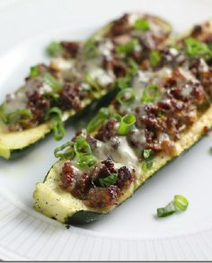 Low FODMAP Recipe and Gluten Free Recipe - Baked zucchini stuffed with spiced lamb & tomato sauce http://www.ibssano.com/low_fodmap_recipe_zucchini_lamb.html