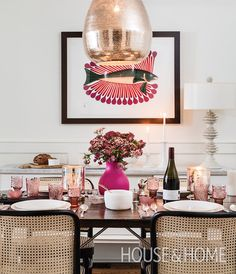 Touches of pink sprinkled throughout this space and the warm glow of mercury glass candles create an enchanting atmosphere.   Photographer: Donna Griffith   Designer: Tanya Linton