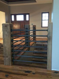 Modern Stair Railing Designs That Are Perfect! Looking for Modern Stair Railing Ideas? Check out our photo gallery of Modern Stair Railing Ideas Here.Looking for Modern Stair Railing Ideas? Check out our photo gallery of Modern Stair Railing Ideas Here. Pipe Railing, Stair Railing, Railing Ideas, Loft Railing, Porch Railings, Railing Design, Metal Spindles, Diy Stair, Modern Railing