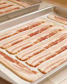 Bacon is its own food group in my house.  :)  Why did not not think of this before...cooking bacon in the oven! Cover cookie sheet with tinfoil. Cook at 375 - 400 degrees for about 20 min. All the bacon is done at the same time, so you can work on cooking the rest of breakfast.