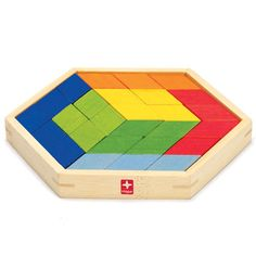 A creative activity with 56 colorful trapezoid and triangle-shaped mosaics. Includes a bamboo frame, cotton drawstring bag and a layout idea guide. __Toy Designer: Aniwat Rerkrai, 2005.