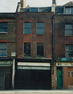 Brushfield Street, Spitalfields, London in the 1980s before the redevelopment of the area.  Shop to the very left edge was home to my 3x great grandfather in the 1850s.  His name is on the plaque on the building - Robert Andrew Cole  (from www.essexvoicespast.com)