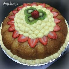 'Baba au vieux rum' - A sweet  french delicacy made of Baba dough,light mousseline cream & adorned with fresh fruits.  #BabaAuVieuxRum #Fruits #Cream #FrenchCakes #ParisianTreats #Ambrosia