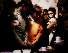 Bill Shankly sharing a cup of tea with some of Melwood's younger locals