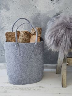 This simple but striking light grey storage basket will adorn any space with grace.