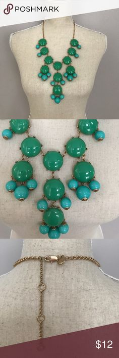 Green & Aqua Bubble Necklace Bubble necklace with gold colored hardware. Gently used. Larger bubbles are medium green and hanging bubbles are aqua. Adjustable lengths with clasp closure. One bubble has minor blemish but barely noticeable. See last photo. Jewelry Necklaces