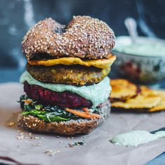 """The 'Bollywood' Burger.  Indian Chickpea & Brown Rice burger patties 2 ways; - Turmeric, Ginger & Coconut - Spicy Harissa & Beet Served with kale slaw,…"""