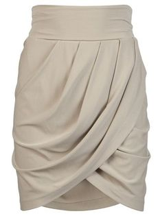 Mini skirt in tan from Plein Sud. This jersey skirt features a foldover waistband, draped wrap front, and gathered waistline.