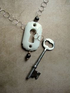 vintage, re-purposed porcelain Escutcheon and Skeleton Key necklace.