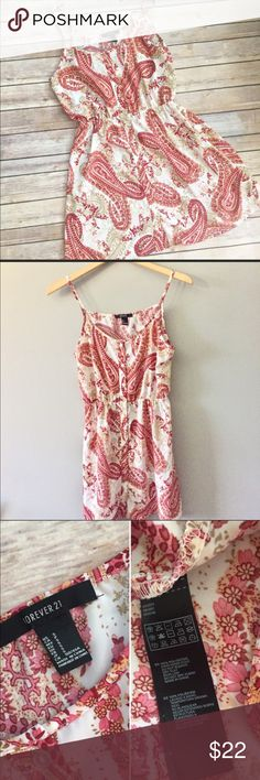 Gorgeous Paisley Dress Gorgeous Paisley Dress size Small in Excellent condition.  Has buttoned detailing down the front.  Exact measurements are pictured above.  This is a three season dress.  Would look so cute with a denim jacket! Forever 21 Dresses