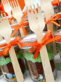 """The layers: edible chocolate rocks, chocolate cake """"dirt"""" and buttercream """"grass"""" all put together in these adorable miniature mason jars and tied up with these amazing birch dessert forks. LOVE."""