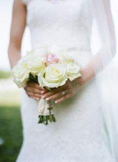 White rose bouquet with a pop of pink: http://www.stylemepretty.com/tennessee-weddings/nashville/2014/09/23/charming-rustic-farm-wedding-in-nashville-at-green-door-gourmet/   Photography: Bamber Photography - http://bamberphotography.com/