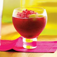 3 1/2 cup(s) pomegranate juice 1 1/2 cup(s) plain or raspberry-flavored light rum 1 cup(s) cassis or cranberry liqueur 1/3 cup(s) fresh lime juice Ice cubes Pomegranate seeds, frozen green grapes, or kiwi slices, for garnish   In a blender, combine 1 1/2 cups juice mixture and 1 cup ice cubes. Blend until slushy. Pour into large martini or wine glasses; garnish as desired. Repeat with remaining juice.