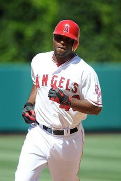 Game #99 7/25/12: Torii Hunter #48 of the Los Angeles Angels of Anaheim runs the bases after hitting a homerun in the eighth inning against the Kansas City Royals at Angel Stadium of Anaheim on July 25, 2012 in Anaheim, California. (Photo by Lisa Blumenfeld/Getty Images)
