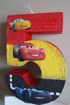 Number pinata inspired by Cars 5th Birthday Party Ideas, Birthday Diy, Birthday Party Decorations, Disney Cars Party, Disney Cars Birthday, Car Themed Parties, Cars Birthday Parties, Piñata Cars, Car Pinata