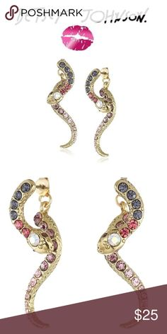 Betsey Johnson Pave Snake Earrings in Purple Betsey Johnson Gold-Tone Pave Snake Front and Back Earring. A front and back snake gives this earring a cute look. Shades of purple and red pave crystals set in gold-tone metal add to the sparkling style of this great accessory.  two blue accent crystals on front studs.  Tail makes up back jacket.  Brand new, never used.  Giftable.  100% authentic- have receipt.  Non-smoking home, pet free zone.  These lovely earrings go with many other…
