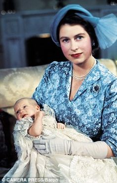 Princess Elizabeth (future Queen) with Princess Anne at her christening, October 21, 1950.