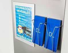 DL wirework leaflet holders with A4 acrylic poster holder. Detail image of a custom totem supplied to Megabus bus terminal.