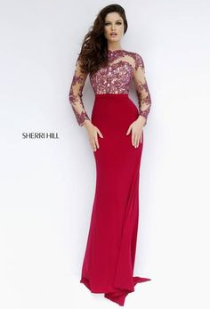 THE LONG FLOWING SKIRT OF THIS DRESS IS WHAT I LOVE ABOUT IT AND THE  LONG  ILLUSION SLEEVE .