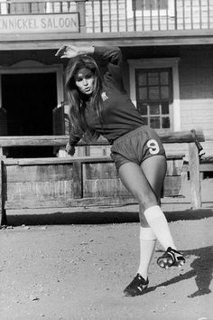 "Raquel Welch, that famous lass of One Million BC fame (give or take ten grand), wearing Peter Osgood's Number .9 strip. She famously also ""scored"" with Os in the lockers of Stamford Bridge, or so the story goes."