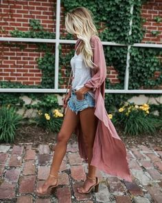 Long pink duster styled with jean shorts