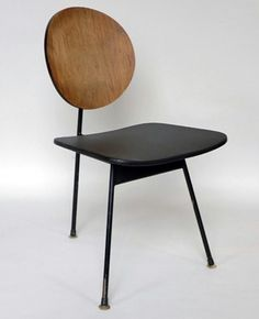 Wooden back rest + plastic seat = modern piece of furniture. We like it.