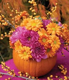 Pumpkin Flower Vase — from Canadian Gardening. They filled a pumpkin vase with autumn mums and berry branches. #falldecor #centerpiece #pumpkinvase #brightideas