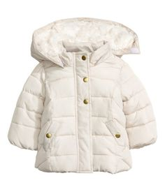 Natural white. Gently flared, padded jacket. Detachable hood with soft pile lining, zip and wind flap at front with snap fasteners, mock pockets, and