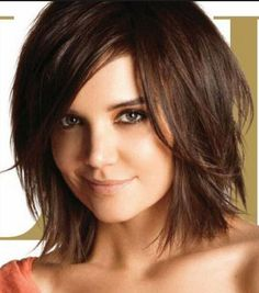 This hair cut and style gets repinned all the time so it's a big favorite. Simple but sexy. Shaggy bobs are so easy to work with and always look great no matter what the state of disarray!  #katieholmeshair #shaggybob