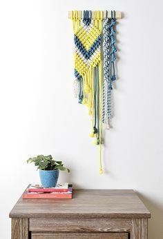 """Hand Dyed Macrame Wall Hanging handmade in Chicago.  This macrame wall hanging is part of Amy's """"Global Color Collection""""  created from hand dyed 100% cotton rope. This collection is inspired from  Turkish, Indian and North African cultures. Amy personally hand dyed all  the colorful"""