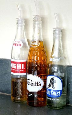 Reuse vintage bottles with pour spouts - great for oils and vinegars.  Plus they look great sitting out on the counter