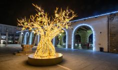 How light art transforms cities and public spaces Chandelier Lighting, Chandeliers, Light Art, Public Spaces, Lights, Table Decorations, City, Christmas Trees, Home Decor