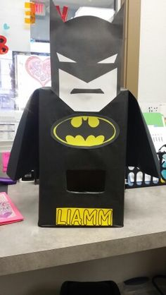 My son's Valentine's Day box for daycare. I borrowed someone else's Batman face & tried to get creative!:)