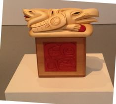 """Dempsey Bob, Tahltan-Tlingit, """"Raven and the Box of Daylight"""", Red and yellow cedar acrylic paint bentwood box"""