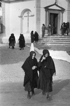 Portugal, Alentejo, Niza. Leaving Sunday mass 1955 by  Henri Cartier-Bresson