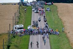 Riders try and get back on their bicycles after a massive high-speed crash just 25 kilometers from the finish line during the sixth stage on July 6, 2012. (Christophe Ena/Associated Press) #